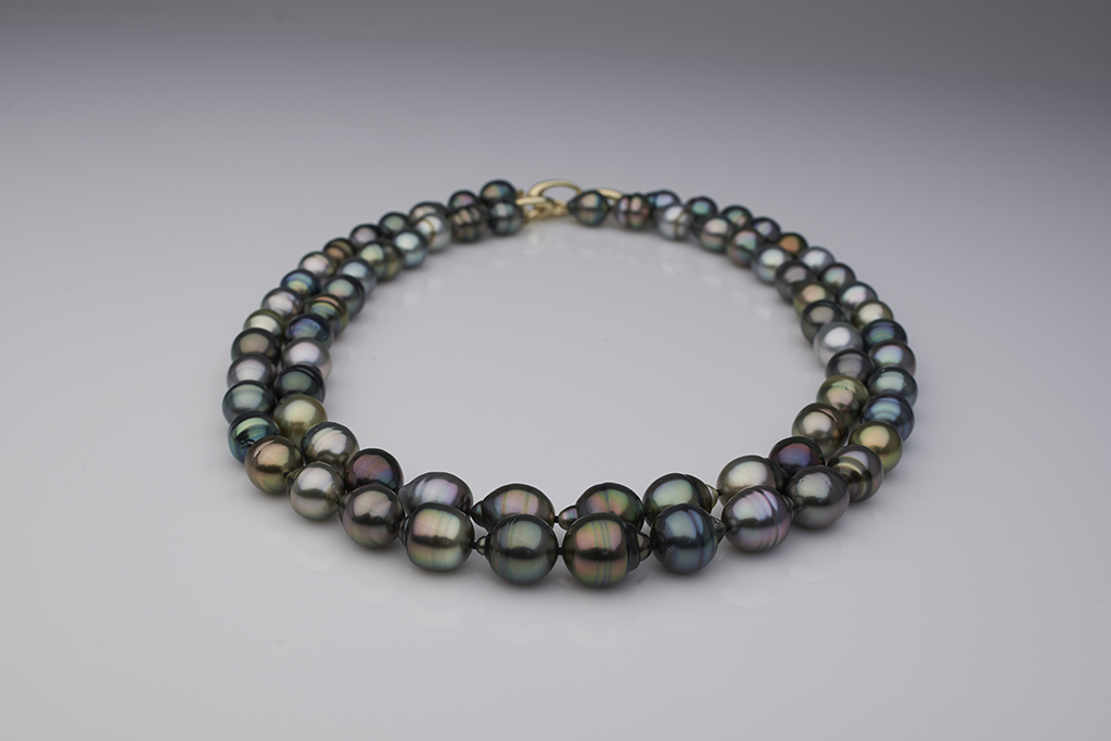 A circle strand of Tahitian pearls purchased from PearlParadise.com. Early on in Cathy's pearl collecting days, she thought she might only purchase one strand of Tahitians. Ha ha—rookie mistake! Today, she's lost count of how many she owns.