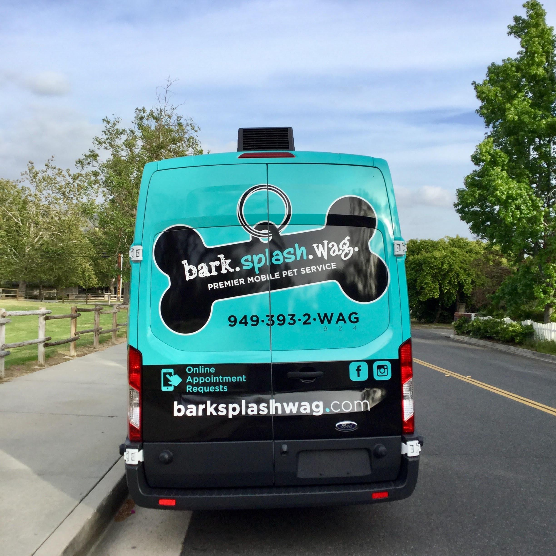 Bark.Splash.Wag. Van back view Outside