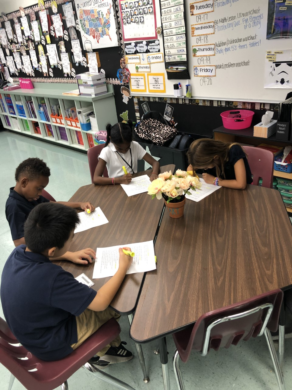 students interpret lyrics of Flocabulary videos as part of small group instruction to learn figurative language and vocabulary