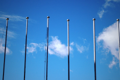 empty flagpoles against sky background