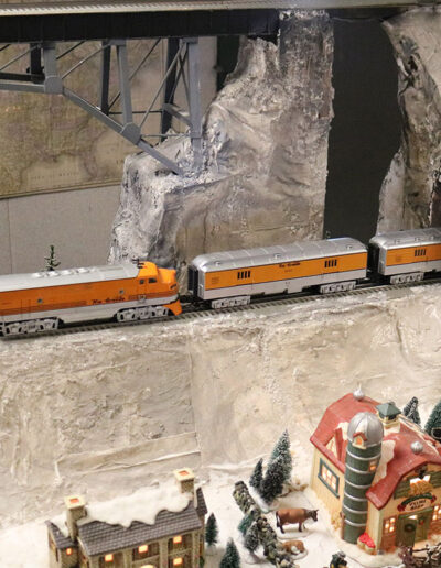 model railroad train going thru tunnel
