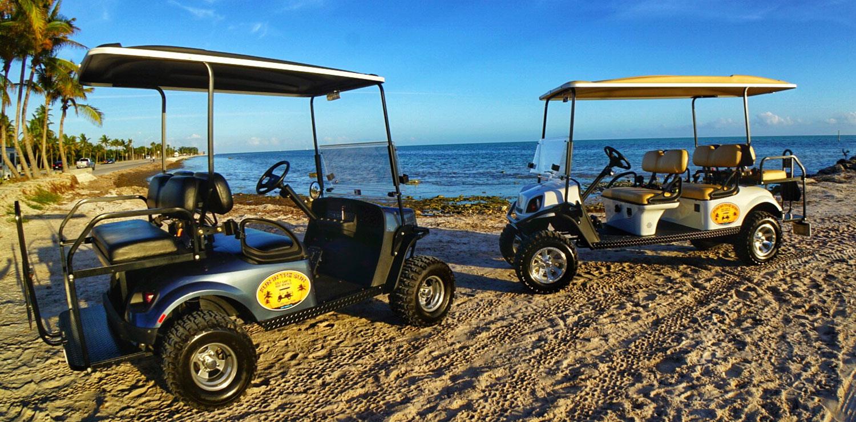 Two EZ GO Golf Carts