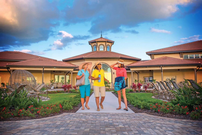 Three ladies arriving at Addison village club pool.