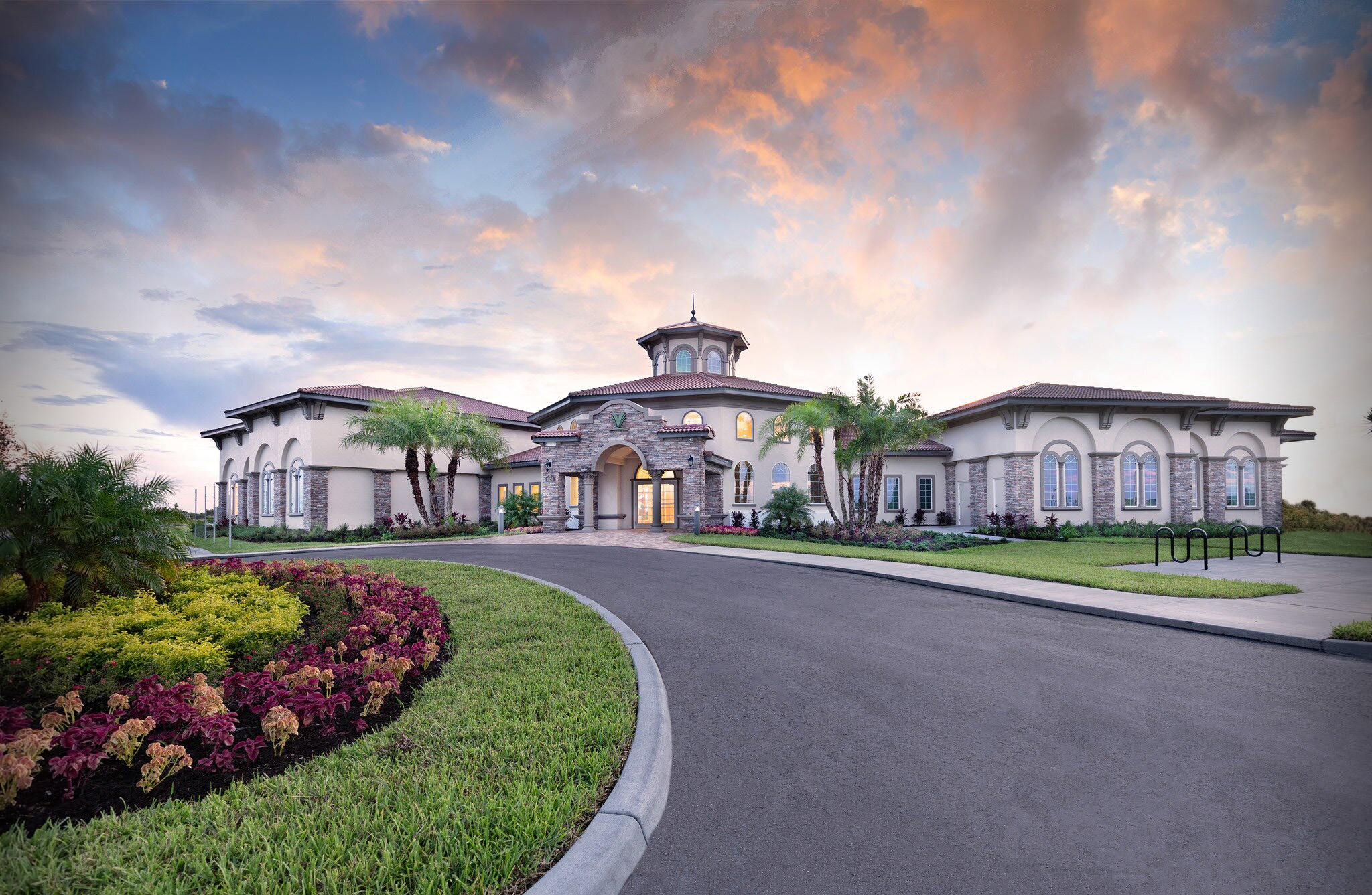 Exterior of Addison Village Clubhouse front at sunset.