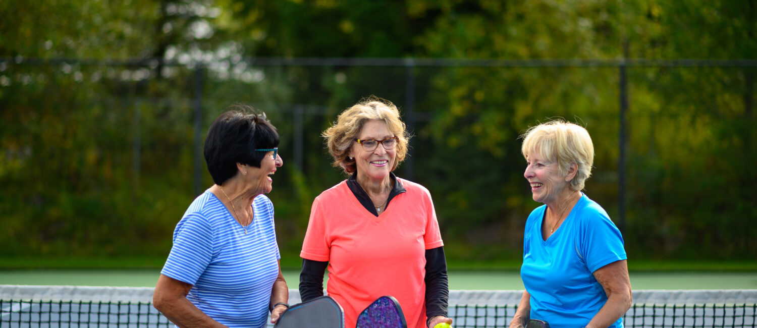 Senior women at a tennis court. Active seniors living a healthy lifestyle. Staying active in retirement.