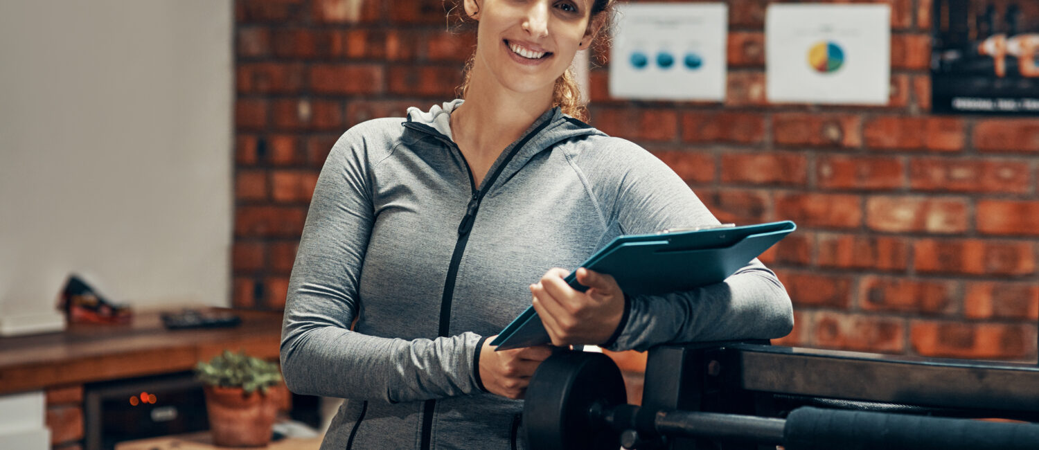 Cropped shot of a fitness instructor holding a clipboard