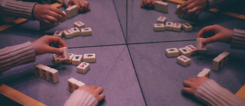 Four players playing mahjong.