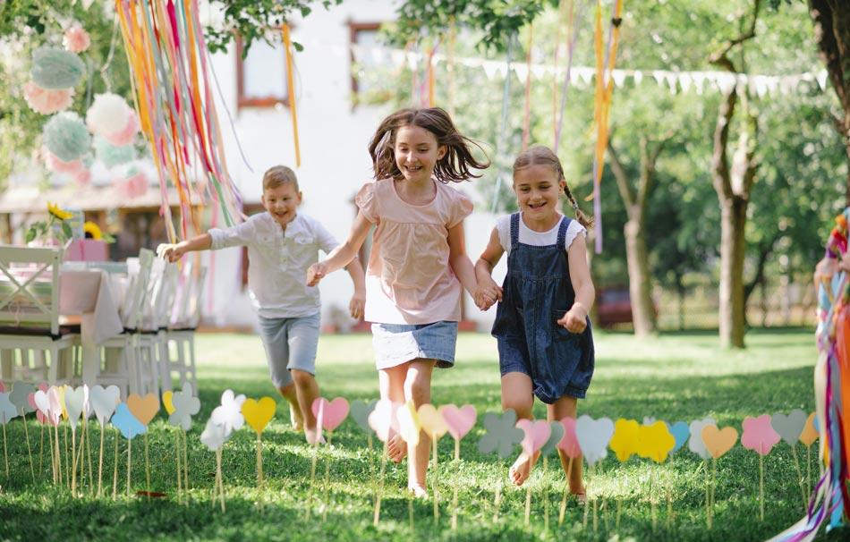small-children-outdoors-in-garden-in-summer-running-when-playing