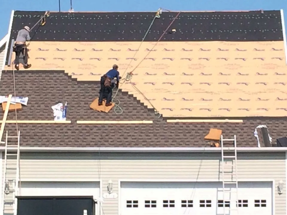 Our contractors working on a roof repair