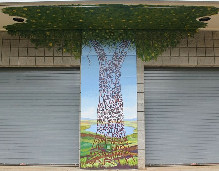 """Friendship Value Tree"" Mural 2013 - 12' x 16' Located at The Clarkston Community Center activity field - painted with the children of Art at the Center Summer Camp. Funded by the Clarkston Community Center and private donations."