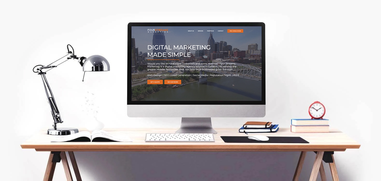 Desk featuring a desktop showing Four Streams Marketing on the screen