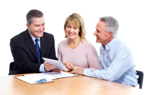 Senior couple with insurance agent at Floyds Insurance in Idaho Falls