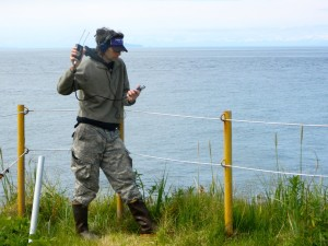 Dr. Fred Sharpe at Five Finger Lighthouse looking at hydrophone receiver.