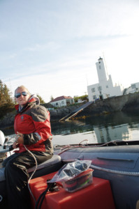 Michele Fournet conducting research at Five Finger Lighthouse, Alaska.