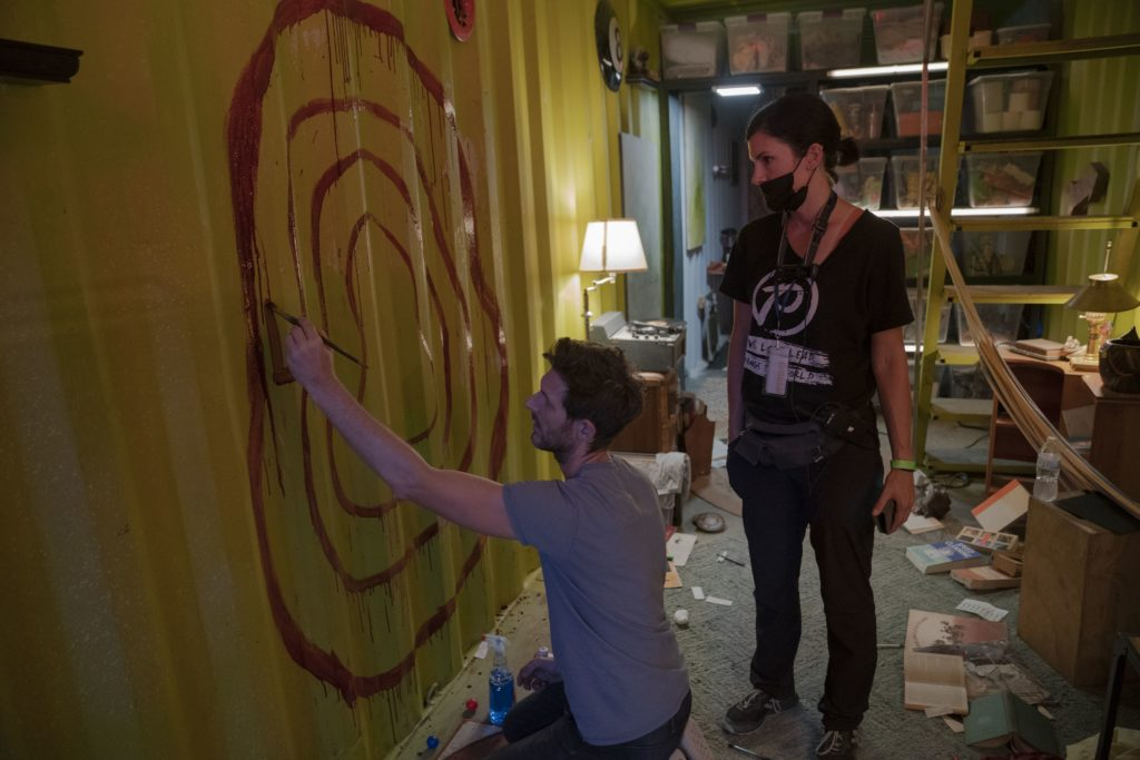 man-painting-a-target