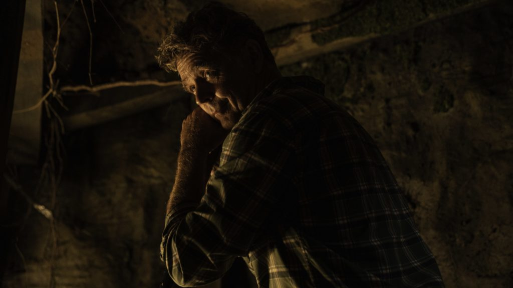 man-being-filmind-in-the-dark