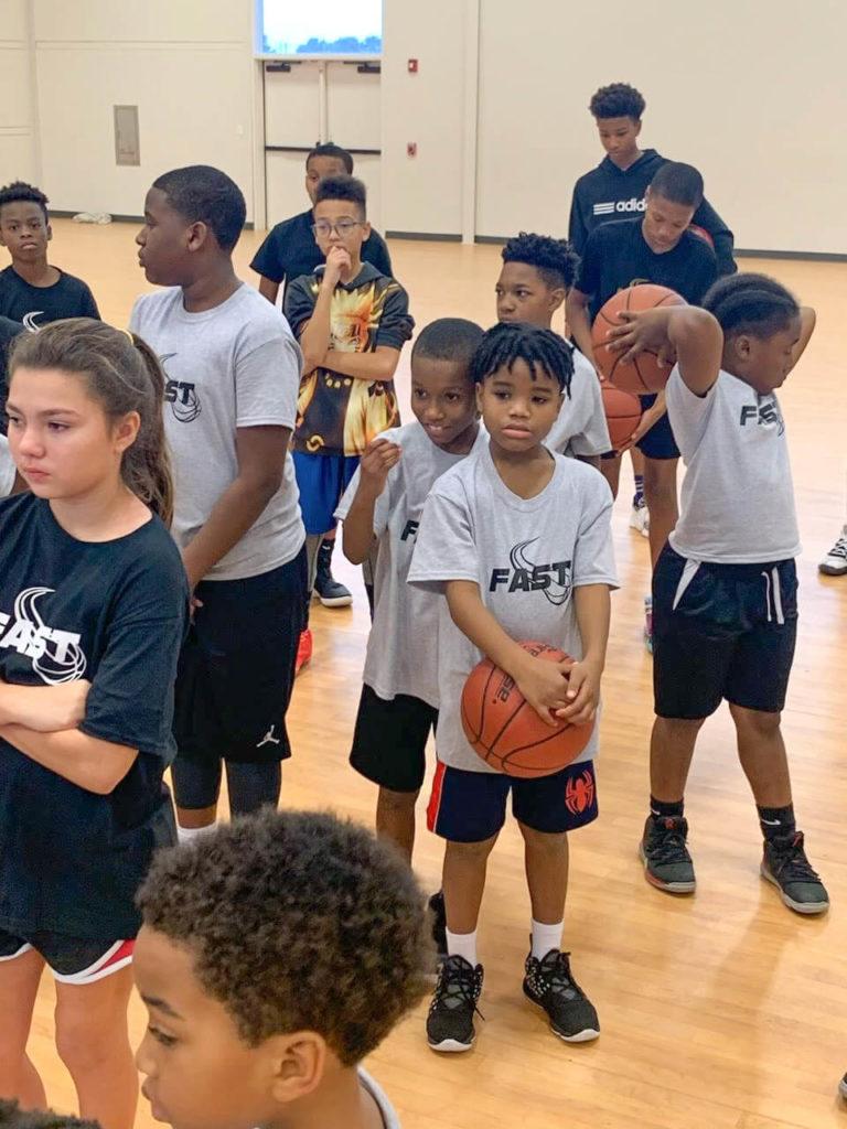 kids-holding-a-basketball