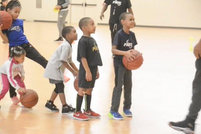 kids-playing-a-basketball