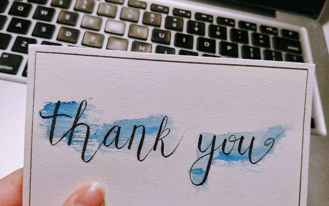 picture of a thank you card with watercolour splashing in the background