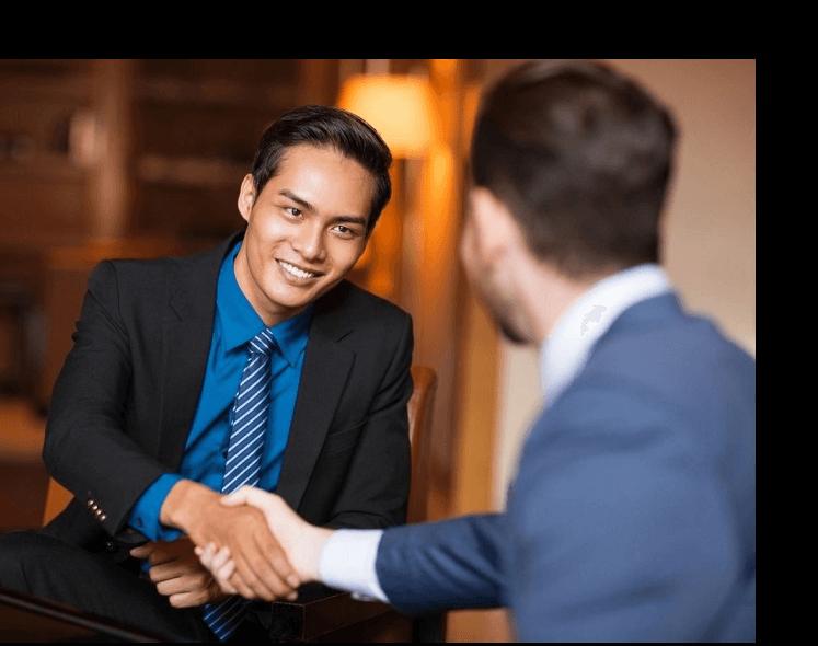 Smiling business men shaking hands