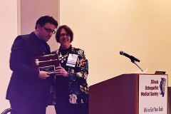 Dr-Longenecker-presents-Dr-Chipman-with-a-plaque-for-his-efforts-as-IOMS-President