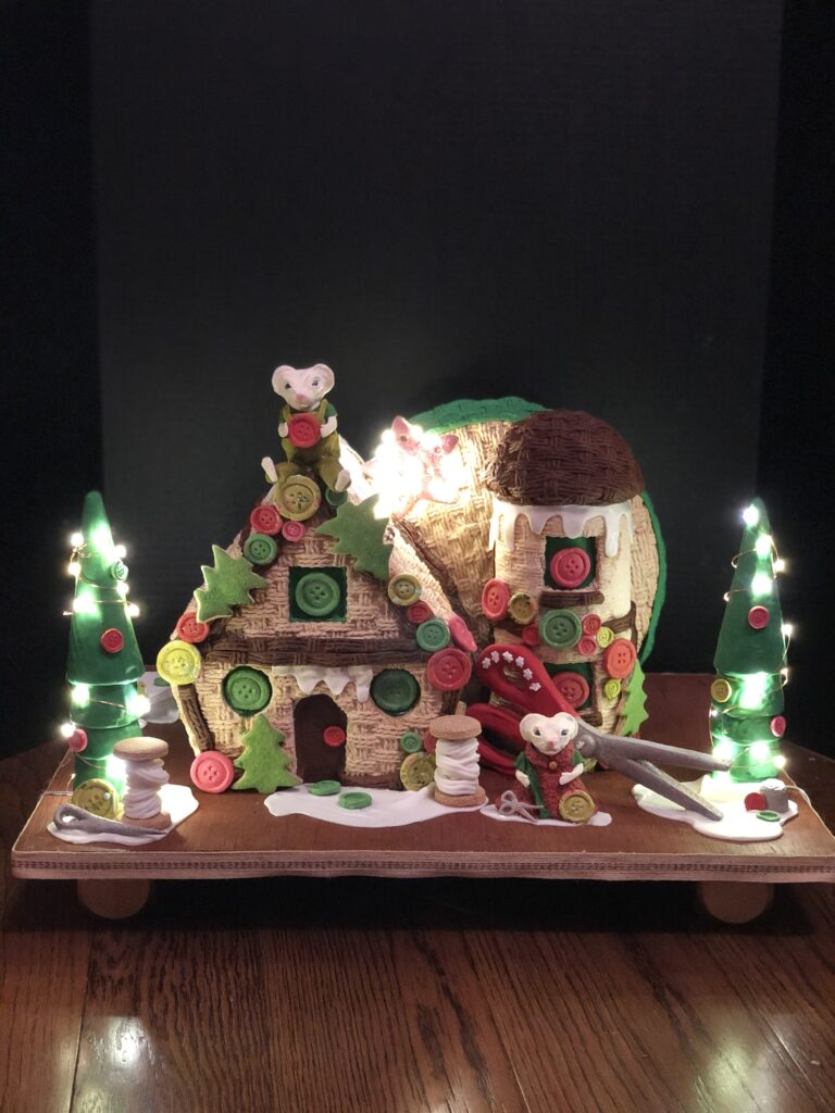 Donation piece for Wake Forest Brenner Children's Hospital. Mouse gingerbread house with lights on.