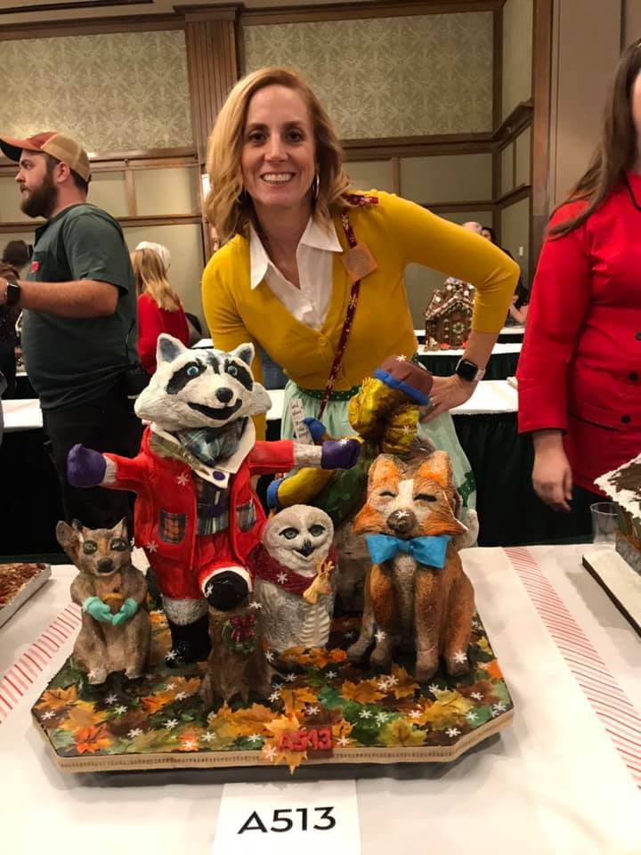 Lindsay Deibler, Ginger Gingerbread Lady, standing with entry for National Gingerbread Competition 2018.