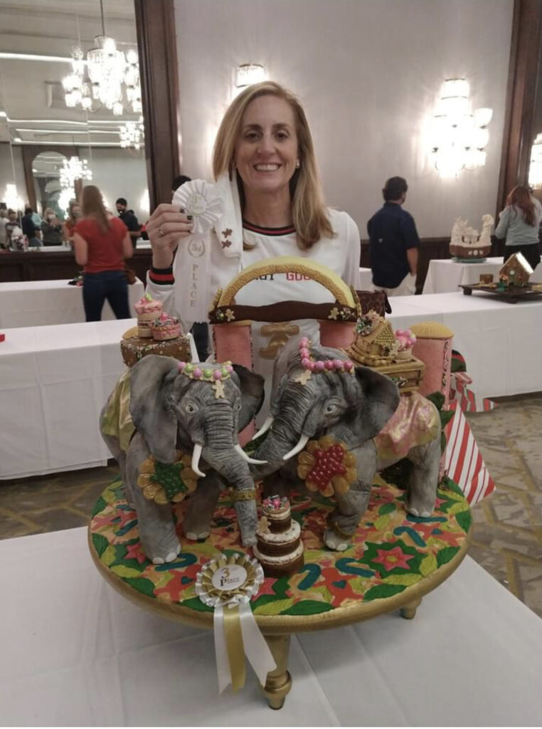 Me holding my third place ribbon at The Savannah Harbor Foundation GIngerbread Competition, 2020.