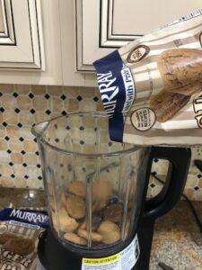 Pouring Murray's Ginger Snaps into the Pampered Chef mixer