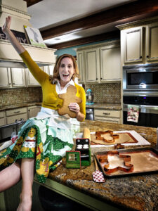 Portrait of Lindsay in her kitchen with gingerbread