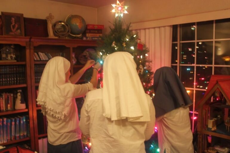 sisters decorate the christmas tree