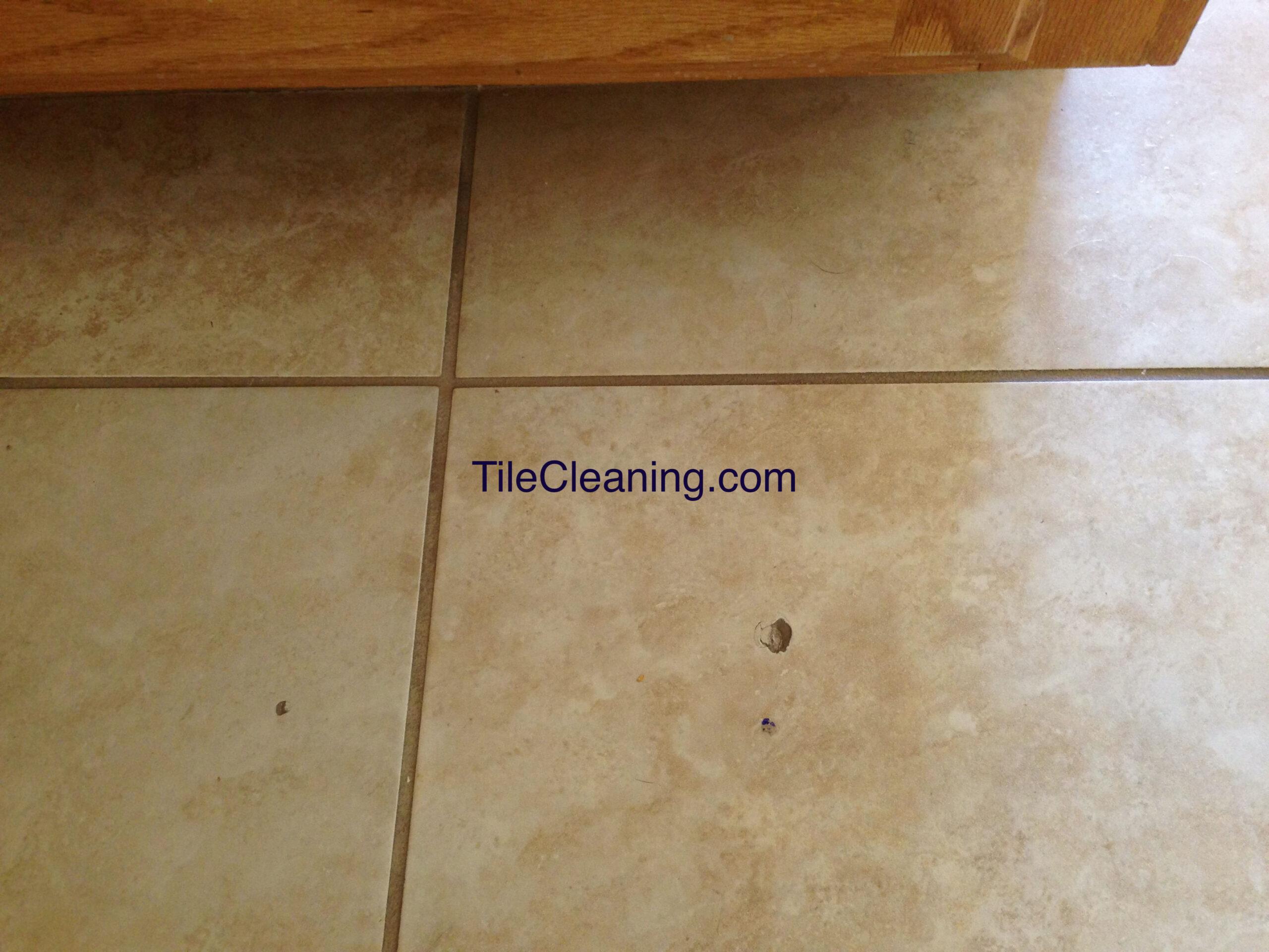 Tile Hole Before Repair