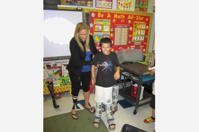 Brooke Artesi demonstrating prosthetics and orthotics in classroom - Sunshine Prosthetics and Orthotics, Wayne NJ