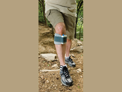Man hiking wearing his WalkAide - unit available at Sunshine Prosthetics and Orthotics in northern NJ