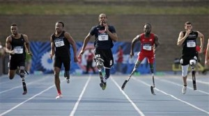 Runners (l-r) Michael Asefa, Desmond Jackson, Shaquille Vance, Regas Woods, and Trevor Wallace compete in the men's 100-meter dash final race during the U.S. Paralympics Team Trials in Charlotte, N.C. (AP Photo/Chuck Burton)