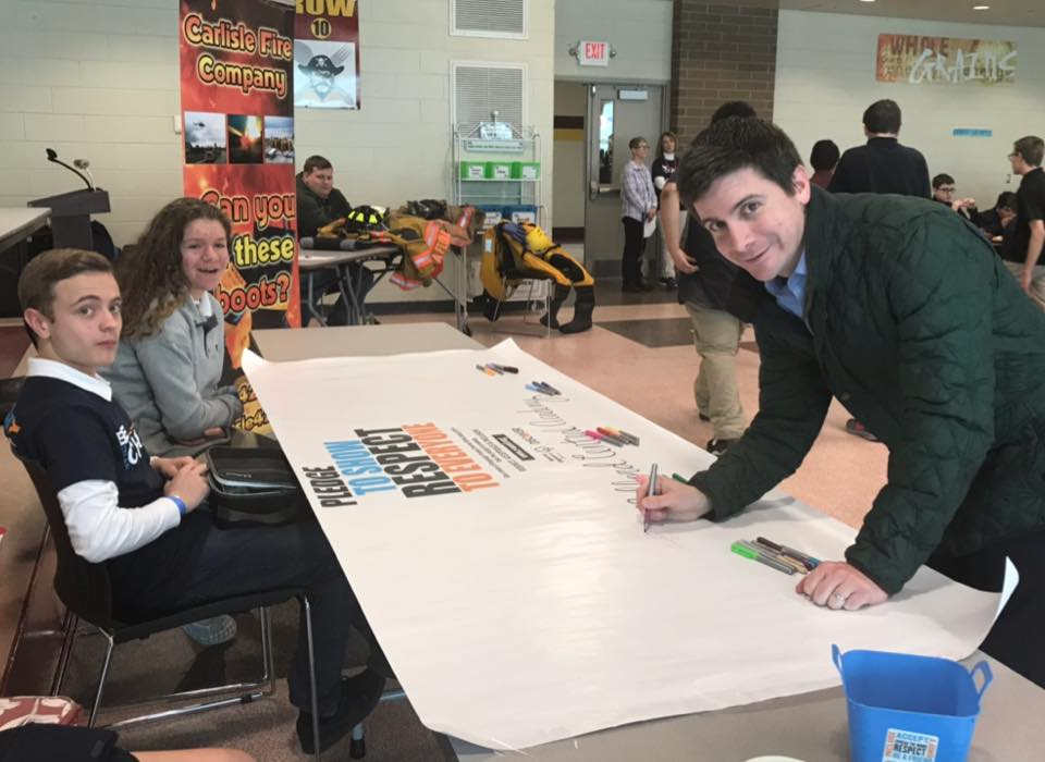 "Signing Milford Central Academy's banner to ""Spread the Word to End the Word."""