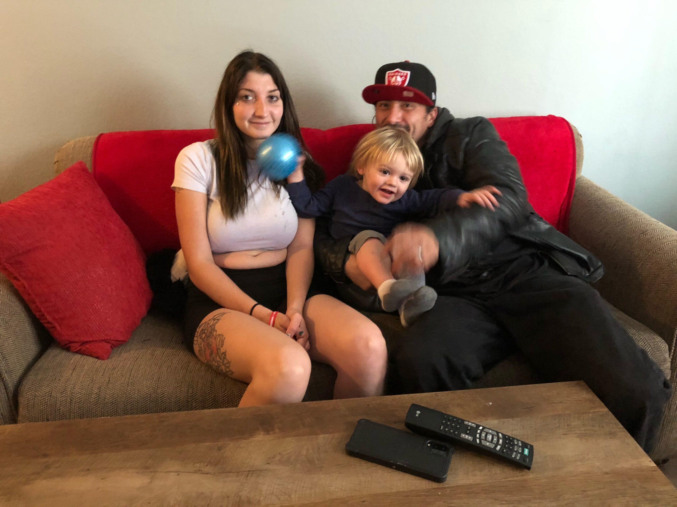 Happy family on sofa