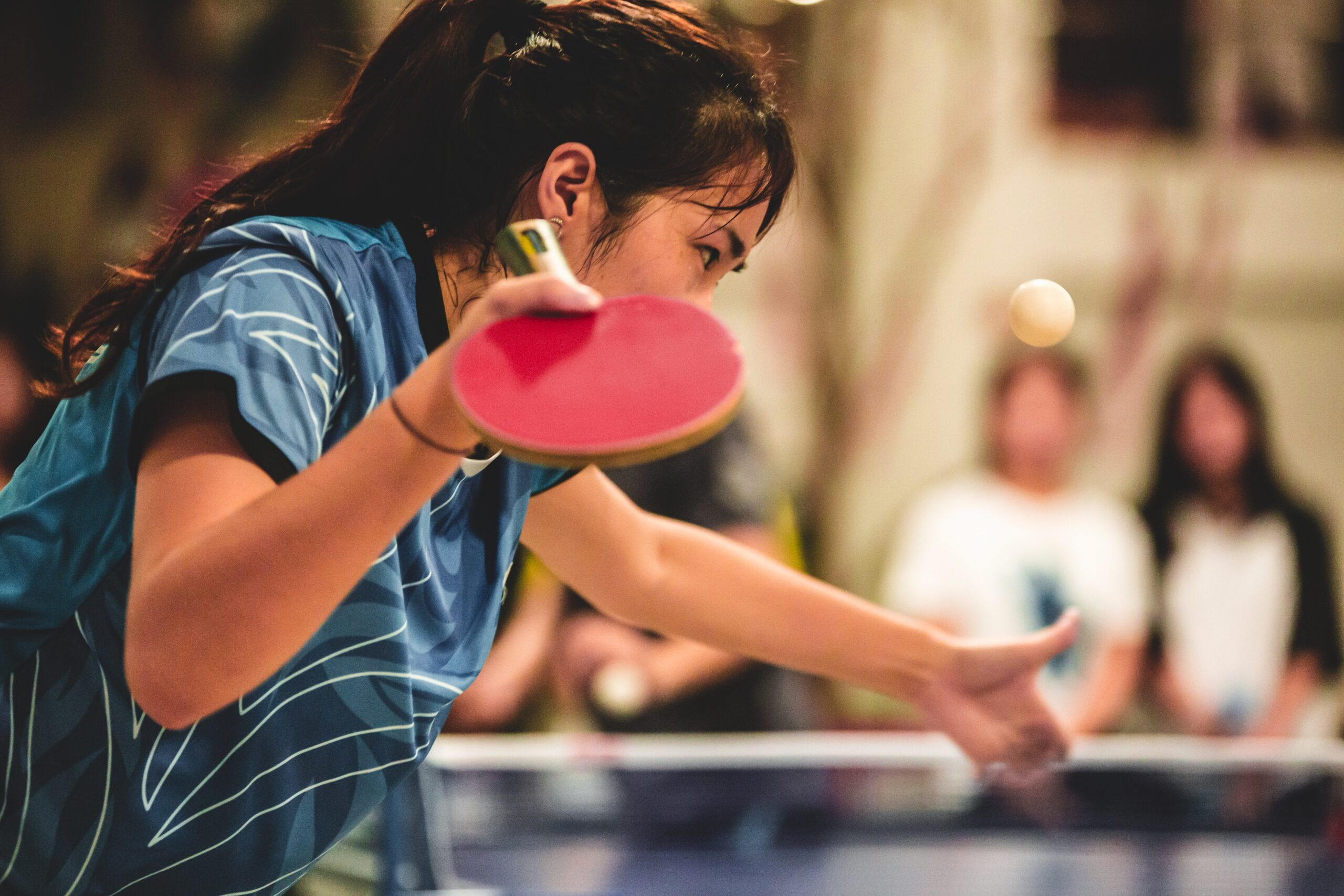 Why do table tennis players grunt
