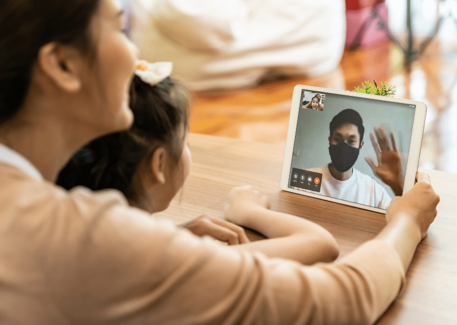 Children on videocall with father during COVID-19