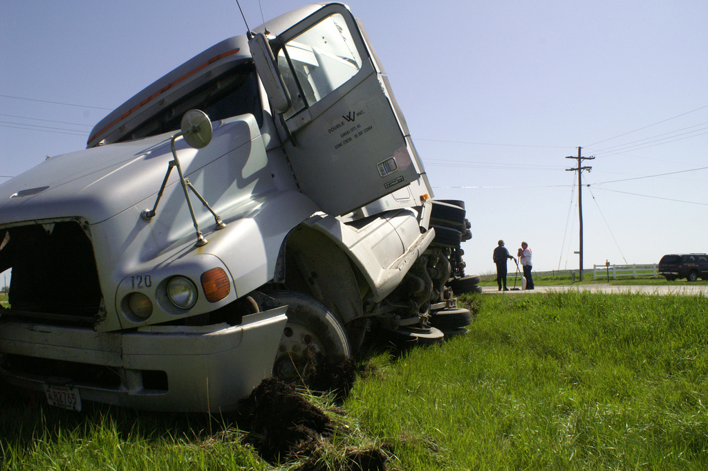 semi truck in road ditch after an accident