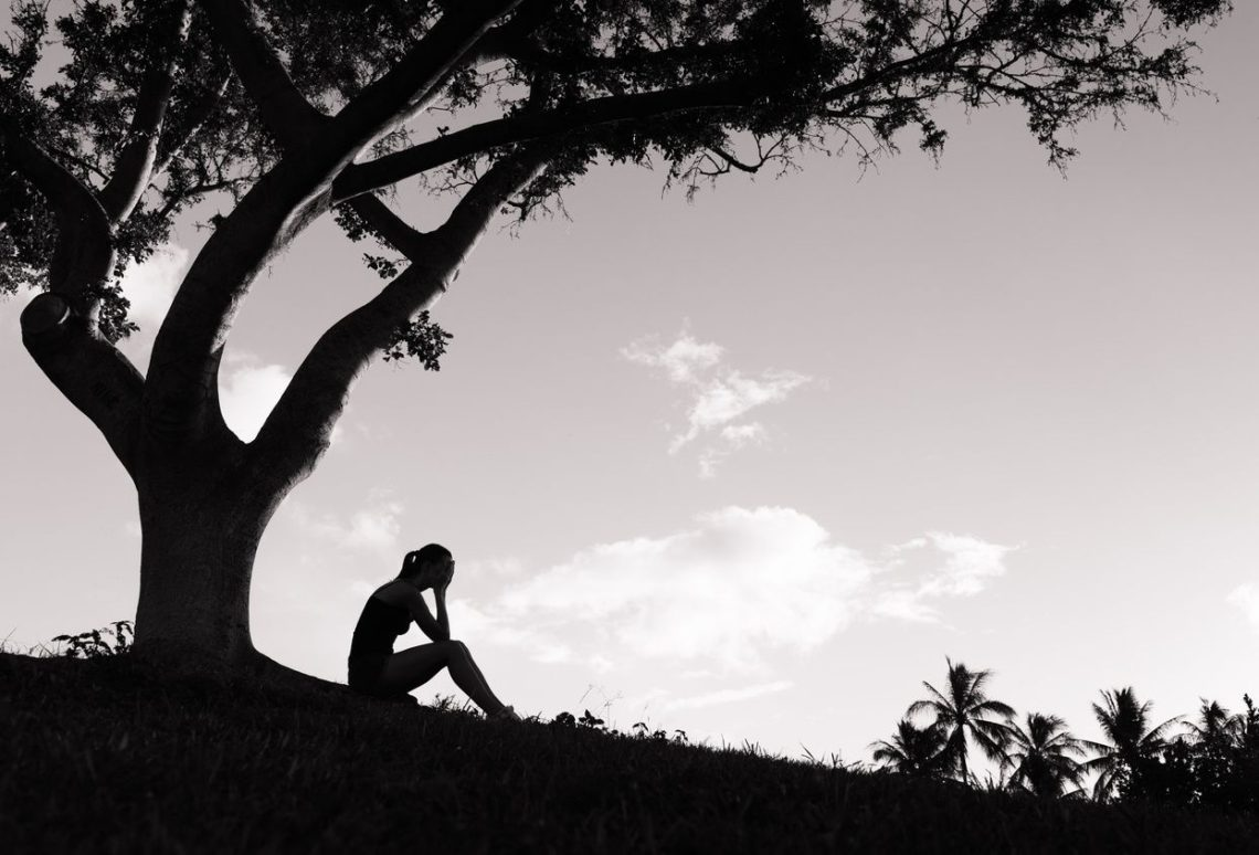 person under a tree