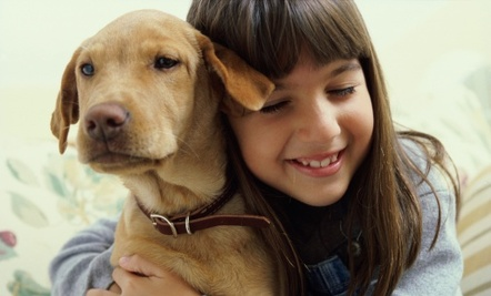 pet loss, how to choose a new dog,choosing a puppy, children and puppies, finding the right puppy, animal human connection, life long friend, sigh of contentment, girl with puppy.