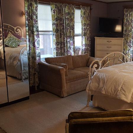 Veranda couch | 1922 Starkey House B&B Inn | Finger Lakes, New York