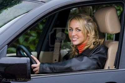 woman pretty smiles and drives