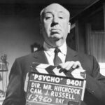 Alfred hitchcock holding a slat for psycho