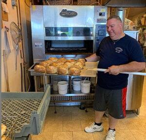 Joe Cino holding bagels