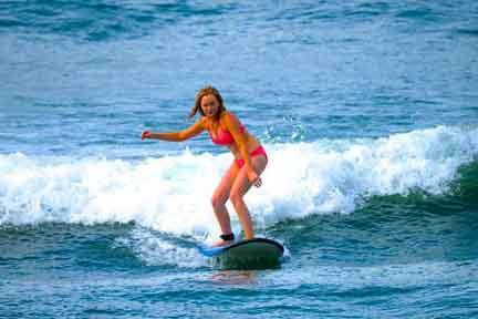 beginner-surfing-Padang-rights-NextLevel-Surfcamp-Bali.jpg