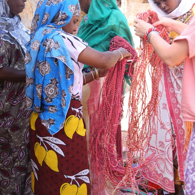 Ladies on Kiwayu Island in the Pacific Ocean, off the east coast of Kenya. Villagers on the island have created toys  and jewelry out of the flip-flop pollution on Kiwayu.  The ladies have created a business that is a good source of income for the island. Pictured here are beaded curtains that have been purchased by Ocean Sole to sell.
