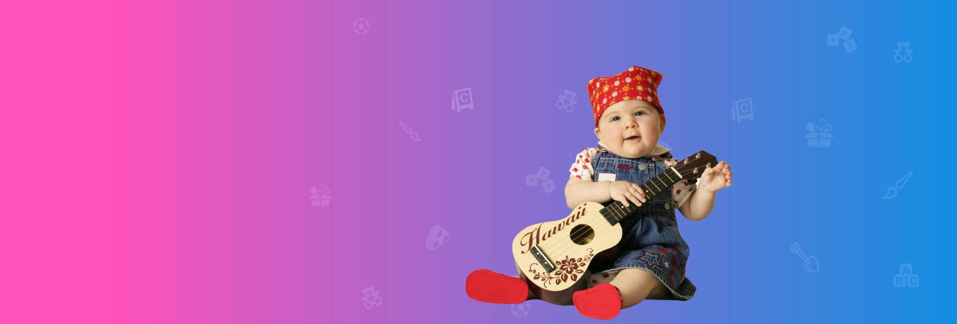 infant holding a guitar
