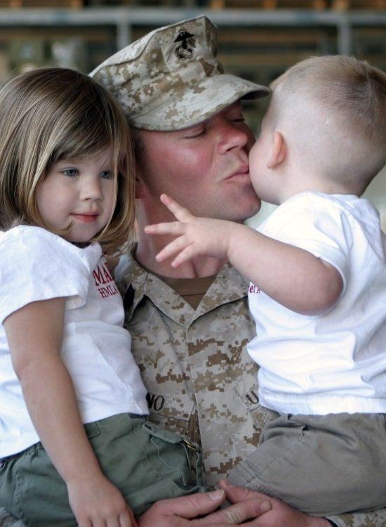 Soldier kissing his children